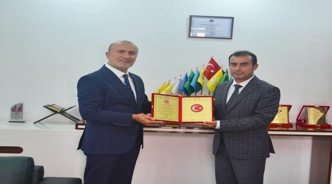 Erbil milletvekiline üstün hizmet ödülü